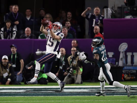 New England Patriots wide receiver Chris Hogan (15) scores a touchdown over Philadelphia Eagles free safety Rodney McLeod (23) during the third quarter in Super Bowl LII at U.S. Bank Stadium.