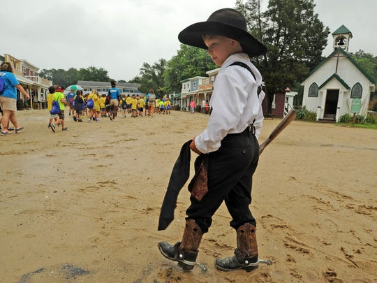 Clay Karson rules the roost at Frontier Town near Ocean City. He's convinced he's a genuine cowboy and sports a pair of worn cowboy boots.
