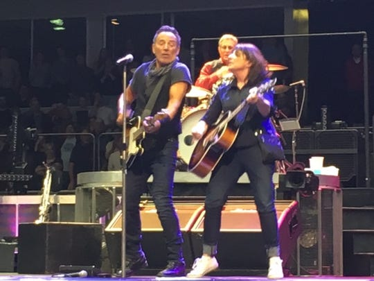 "Bruce Springsteen and Teri Walderman rock out during ""Dancing in the Dark."""