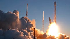 An unmanned Falcon 9 SpaceX rocket lifts off from launch