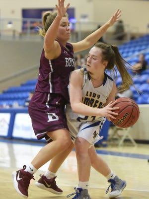 Mountain Home's Riley Walker is defended by Benton's Anna Davis on Wednesday at West Memphis.