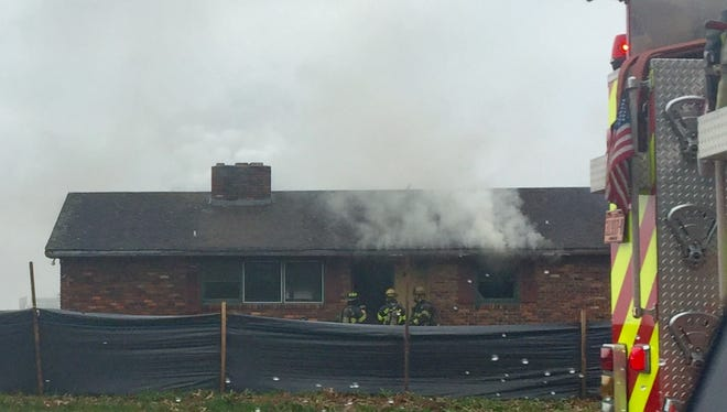 The Asheville Fire Department on Saturday conducted a controlled burn at this home on Long Shoals Road.