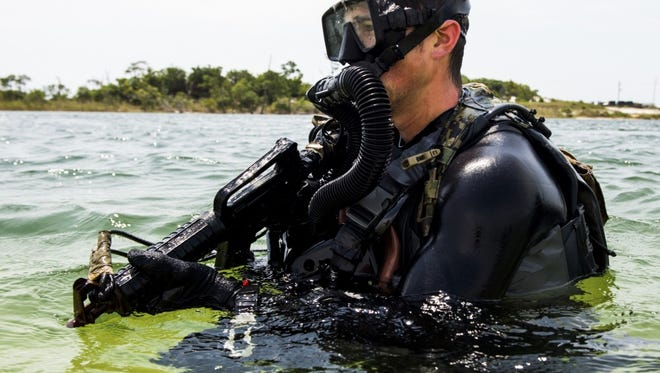A member of the Navy SEALs train in Florida. The Navy is proposing intensifying special operations training it does in Kitsap and Jefferson County, and the public can weigh in on the proposal.
