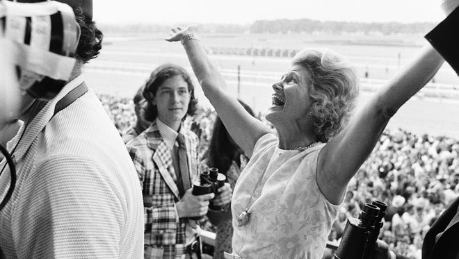 FILE - This June 9, 1973, file photo shows Penny Chenery, owner of Secretariat, reacting after her horse won the Belmont Stakes, and the Triple Crown, at Belmont Park in Elmont, N.Y. Chenery, who bred and raced 1973 Triple Crown winner Secretariat as well as realizing her disabled father's dream to win the Kentucky Derby in 1972 with Riva Ridge, died Saturday, Sept. 16, 2017, at her Boulder, Colo. home following complications from a stroke, her children announced Sunday through Leonard Lusky, her longtime friend and business partner. She was 95.  (AP Photo/Jack Kanthal, File)