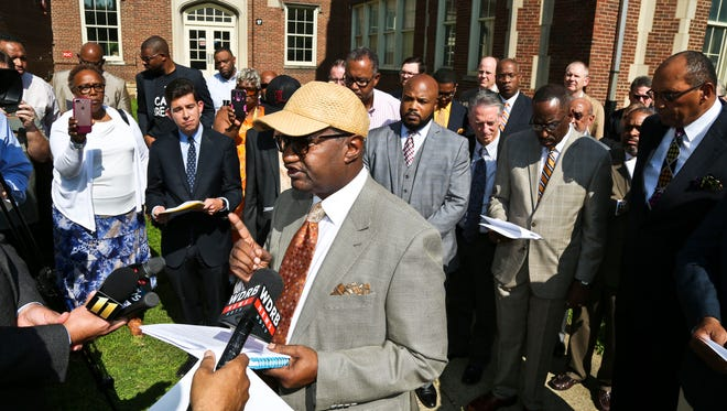 Rev. Clay Calloway spoke for more than a dozen ministers before the start of Gov. Matt Bevin's ideas on how to curb violence. Calloway said Louisville's West End is a 'low-to-no opportunity community' and that economic means are needed to improve lives and help lessen 'the nihilism' that lack of opportunity and hope creates.