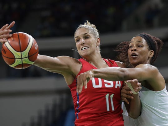 File- This Aug. 18, 2016, file photo shows United States' Elena Delle Donne (11) and France's Marielle Amant, right, reaching out for the ball during a women's semifinal round basketball game at the 2016 Summer Olympics in Rio de Janeiro, Brazil. Delle Donne is back, although she's not at 100 percent yet. Washington's star forward will return to the Mystics lineup Friday, Au. 18, 2017,  when they visit the New York Liberty. She has been sidelined since the beginning of August with a torn ligament in her left thumb. The Mystics' leading scorer missed six games and Washington went 3-3. (AP Photo/Eric Gay, File)