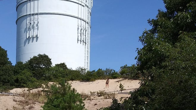 "The view that audiences will have of actors performing ""The Municipal Abbatoir"" on a dune next to a parking lot for the Provincetown Tennessee Williams Theater Festival."