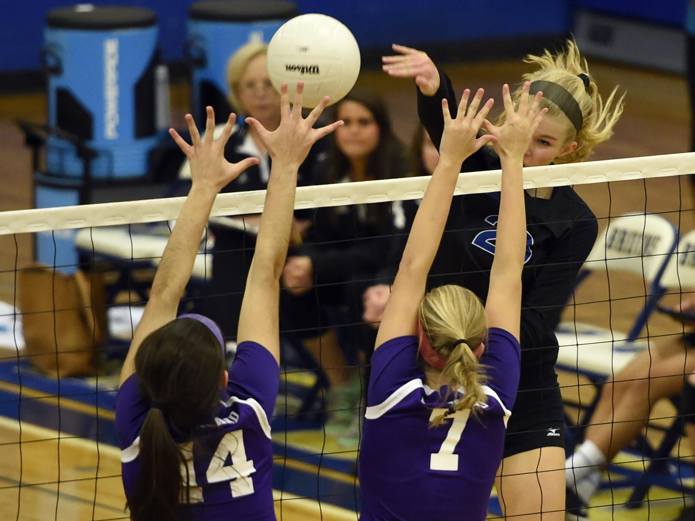 Brentwood's Garrett Joiner spikes the ball past Portland's McKenzie Trouten (14) and Sidney Minnis (7) during their match Thursday.