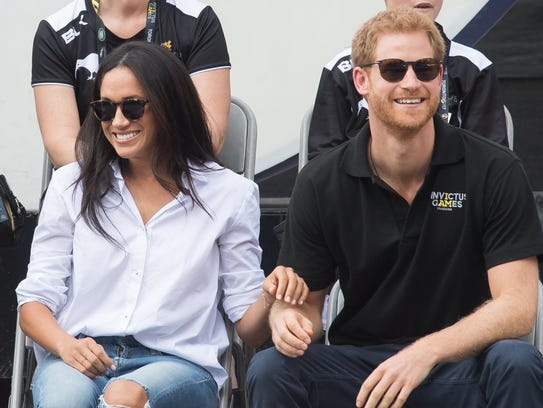 Prince Harry and Meghan Markle looked cozy and close