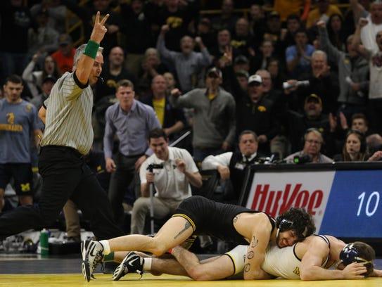 Iowa's Vince Turk wrestles Michigan's Sal Profaci at