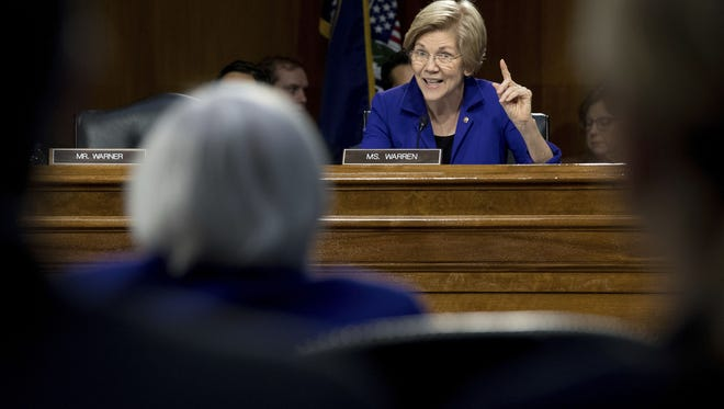 Senate Banking Committee member Sen. Elizabeth Warren, D-Mass., enlisted Federal Reserve Chair Janet Yellen to argue that business lending has not been hindered by the Dodd-Frank financial reform.