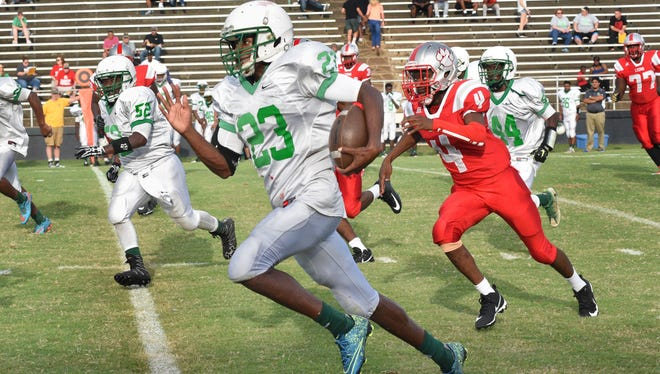 Bossier's Decamerion Richardson breaks away for a long run against Plain Dealing in the 64th annual Lions Club Football Jamboree.