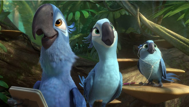 """This image released by 20th Century Fox shows (from left) Blu, voiced by Jesse Eisenberg, Jewel, voiced by Anne Hathaway and Carla, voiced by Rachel Crow, in a scene from the animated film """"Rio 2."""""""