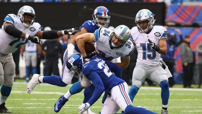 Lions running back Zach Zenner fumbles on a tackle by Giants cornerback Leon Hall in the first half at MetLife Stadium on Dec. 18, 2016 in East Rutherford, N.J.