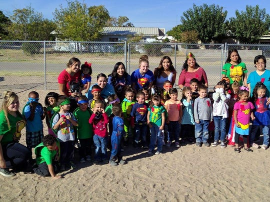 "Students and staff at the Family Resource Center were visited by the Deming High School Cheerleaders during Red Ribbon Week back on Oct. 24. The cheerleaders led the students through the 21-Day Challenge to encourage children to exercise and strive to be physically fit. ""The focus was on our student's well-being and to celebrate Spirit Week during Red Ribbon Week,"" said Dolores Lopez of the Family Resource Center, a Home Education Livelihood Program-New Mexico (HELP-NM)."