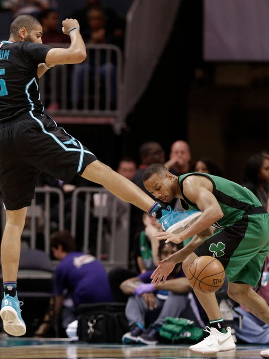 Boston Celtics' Avery Bradley, right, steals the ball from Charlotte Hornets' Nicolas Batum during the first half of an NBA basketball game in Charlotte, N.C., Saturday, April 8, 2017. (AP Photo/Chuck Burton)
