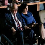 In this file photo, New Orleans Pelicans and New Orleans Saints owner Tom Benson and his wife Gayle Benson watch from the owners suite during a Pelicans game at the Smoothie King Center in New Orleans.