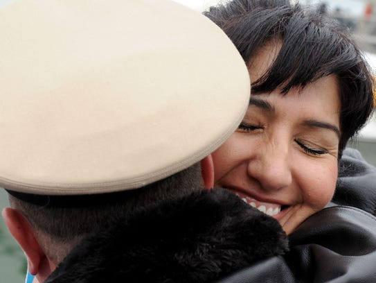 Evangelina Amaral receives a hug after becoming a citizen