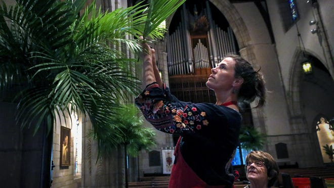Ann-Marie Reiman, left, and Jane Purrington construct palm trees inside The Episcopal Church of Bethesda-by-the-Sea in 2019 for Palm Sunday. Because of the coronavirus pandemic, the church is broadcasting its Palm Sunday service online alongside Royal Poinciana Chapel.