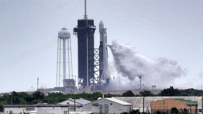 SpaceX Falcon 9 vents during fueling about 15 minutes before the launch was scrubbed due to lightning in the area of Launch Complex 39-A at Kennedy Space Center, Florida, on July 8, 2020.