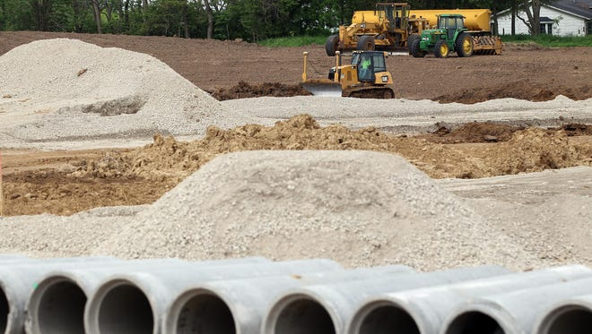 Dirt is moved in preparation for laying foundation for the new Solon Middle School on Friday, May 29, 2015.