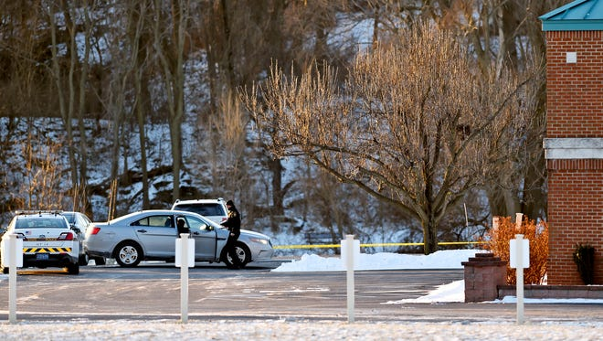 A law enforcement officer walks outside of Stillmeadow Church of the Nazarene in Manchester Township Saturday, Jan. 6, 2018. A shooting was reported there around 3 a.m. and the York County coroner was called to the scene, according to York County 911.