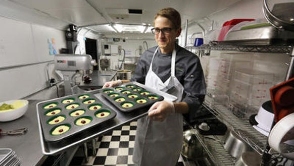 Chef Alex Tretter carries a tray of cannabis-infused