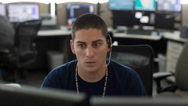Brendan Solano intercepts 911 calls and directs emergency and non-emergency help at the Fort Collins 911 dispatch center Monday, June 13, 2016.