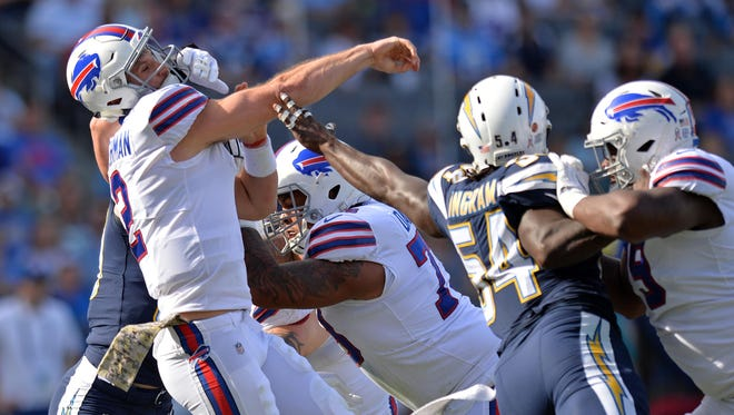 Nov 19, 2017; Carson, CA, USA; Buffalo Bills quarterback Nathan Peterman (2) is hit by Los Angeles Chargers defensive end Joey Bosa (not seen) as he throws during the first quarter at StubHub Center. Mandatory Credit: Jake Roth-USA TODAY Sports