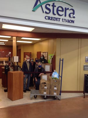 Astera Credit Union's Ionia branch, located inside Walmart Supercenter, 3062 S. State Road, in Ionia, teamed up with Walmart to donate Thanksgiving to the Zion Community Food Pantry, according to a press release.