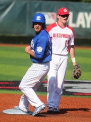 CovCath senior Logan Beagle reaches second after a sacrifice bunt during Covington Catholic's 6-0 win over Beechwood in the 35th District baseball championship game May 23, 2018 at Meinken Field, Covington KY.