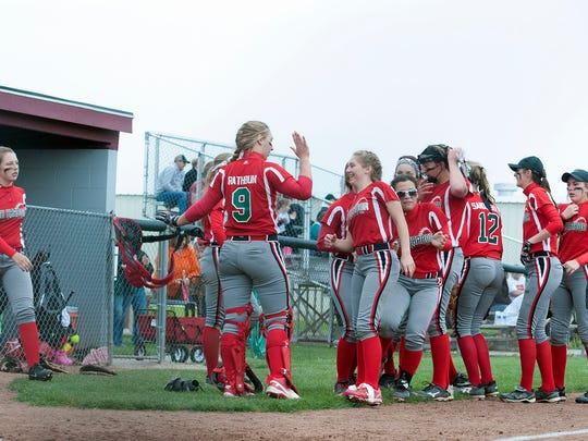 The Oak Harbor Rockets softball team celebrates after defeating Wauseon at Genoa Area High School on Tuesday. The girls will play in the district final on Saturday.