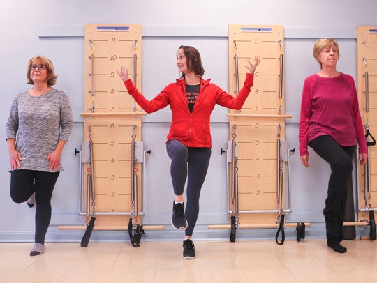 Instructor Claire Greenlee, center, demonstrates a