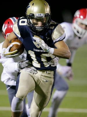 Jack Van Ekeren of Appleton North carries the ball against Neenah in a WIAA Division 1 second-round playoff game Friday, October 27 2017, at Paul Engen Field at Appleton North High School in Appleton, Wis.
