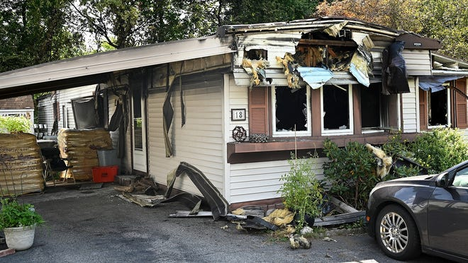 A mobile home in the Meadowbrook Mobile Park at 18 Teresa Drive in Hudson was heavily damaged following a fire Tuesday night.