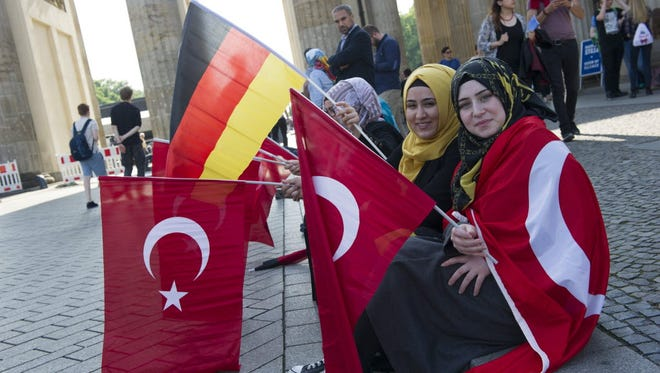People protest with Turkish and German flags in Berlin on June 1. Some 1,000 people protested in solidarity with Turkey against the German parliament's resolution condemning the Armenian Genocide of 1915.