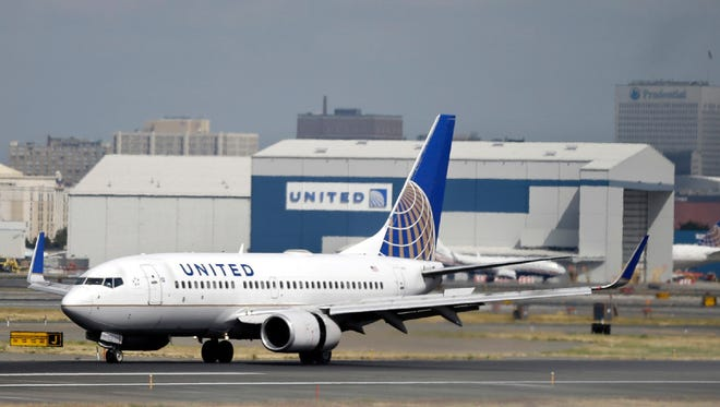 A United Airlines passenger plane lands at Newark Liberty International Airport.