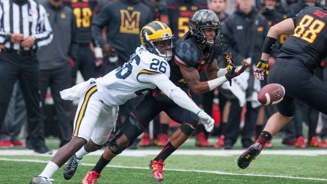 Jourdan Lewis bats away a ball during the Maryland game.