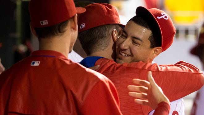 Philadelphia Phillies' Vince Velasquez gets hugs from teammates during the seventh inning Saturday against the Atlanta Braves. It was Velasquez's last start of the season. The Phillies shut down the righthander.