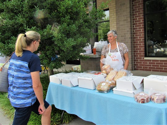 Perennial favorite VG's Bakery has been tempting shoppers since the market opened in 2008. Leslie Lett was ready to serve the next customer.