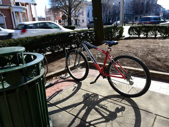 Cyclists can secure their bikes in racks, as seen Tuesday,