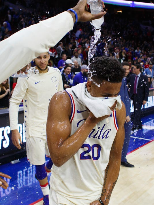 Philadelphia 76ers' Markelle Fultz gets doused by water after the team's NBA basketball game against the Milwaukee Bucks, Wednesday, April 11, 2018, in Philadelphia. The 76ers won 130-95. (AP Photo/Chris Szagola)