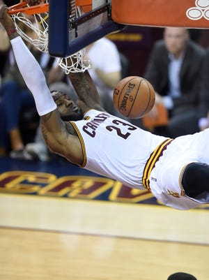 LeBron James dunks the ball during the third quarterin Game 6 at Quicken Loans Arena.