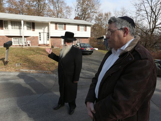 Rabbi Yechiel Halberstam, left, recently sold this