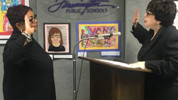 Before Tuesday's meeting, Judge Marla Parker administered the oath of office to new Farmington Board of Education trustee Angie Smith.