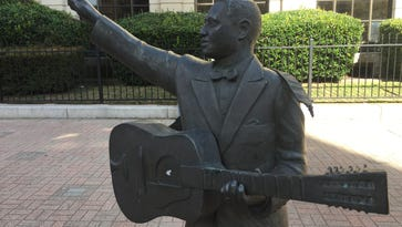 Get 'er Done: Lead Belly's guitar strap is broken