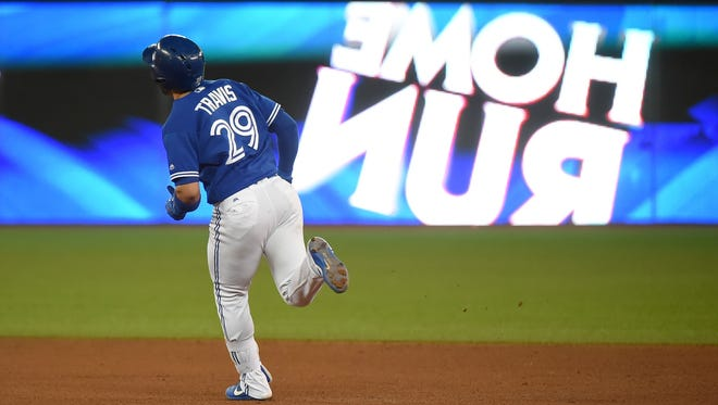 Devon Travis hit a two-run homer off of Wandy Peralta in the seventh inning to lead the Blue Jays to a 5-4 victory over the Reds on Wednesday.