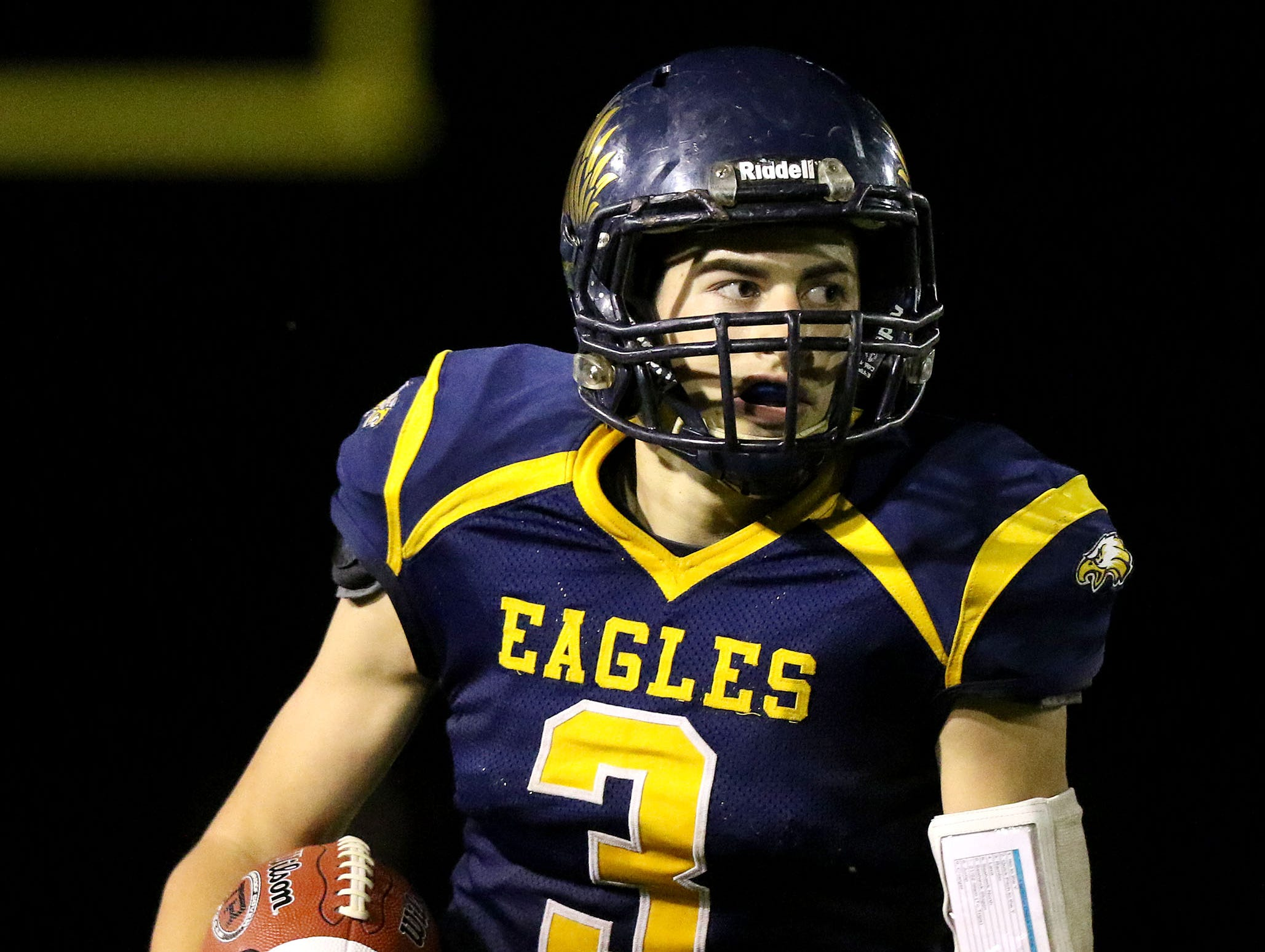 Stayton High School's Ben Diehl (3) runs the ball against Newport on Friday, Sept. 25, 2015, in Stayton, Ore.