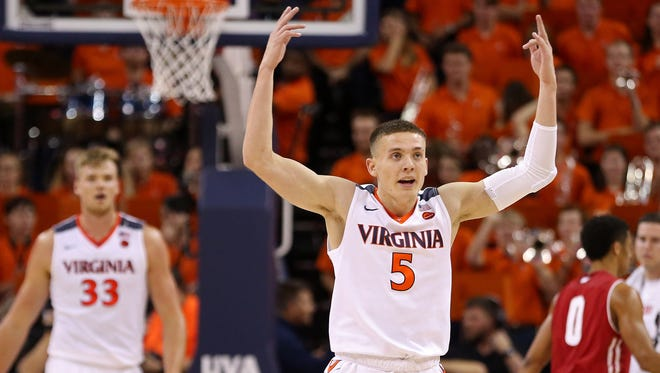Virginia guard Kyle Guy (5) celebrates during the Cavaliers' game against Wisconsin in the second half at John Paul Jones Arena in Charlottesville, Va.