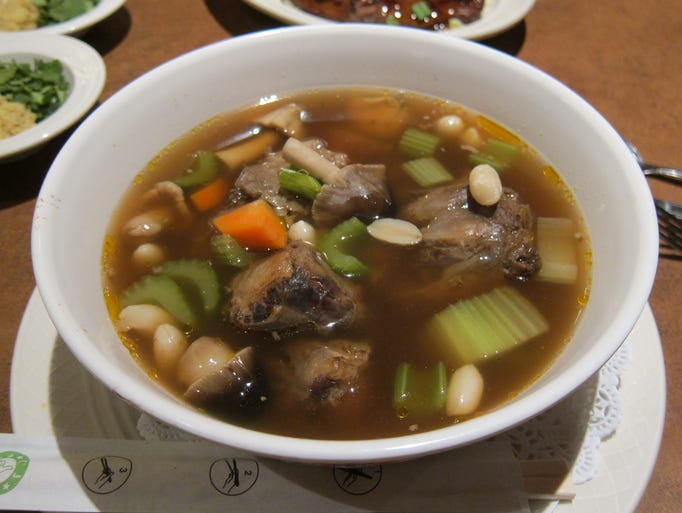 Market Street Cafe's oxtail soup, served nightly after 11 p.m., is the customer favorite. The eatery serves 800 pounds of oxtail a night. Big chunks of meat are finished with celery, carrots and crunchy peanuts in a rich, beefy broth, and served with white rice and hot chili sauce.